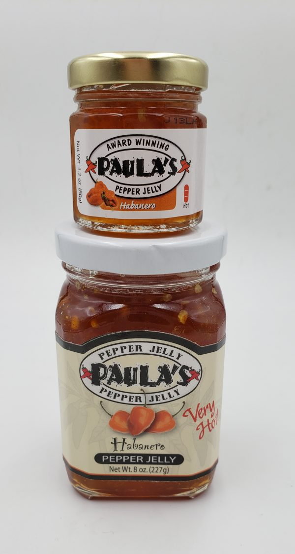1.7 oz. Paula's Pepper Jelly jar on top of the full 8 oz. habanero pepper jelly jar. Both labels are facing outward.